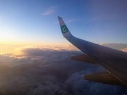 En avion